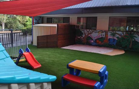 Mermaid Waters Childcare Centre Makeover lush synthetic grass slides