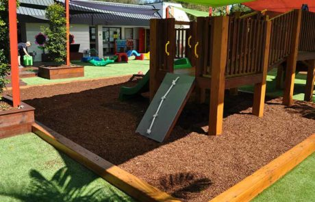 Mermaid Waters childcare centre sandpits surrounded by lush synthetic grass