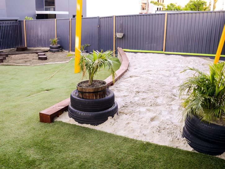 Cubbycare playground, sand and plants