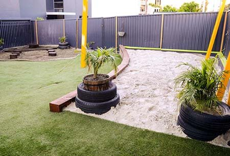 Plants, sand pit and Astro turf