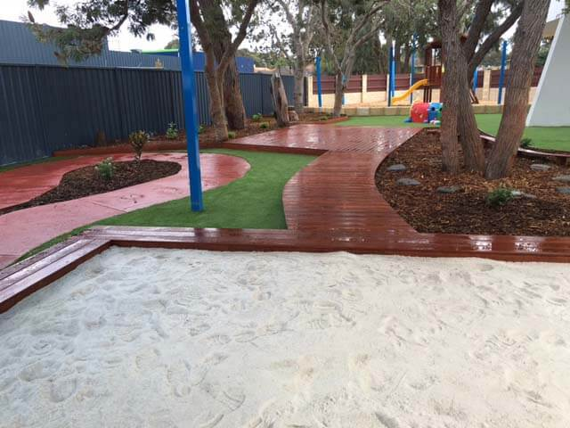 Sand pit, wood work and plants in playground