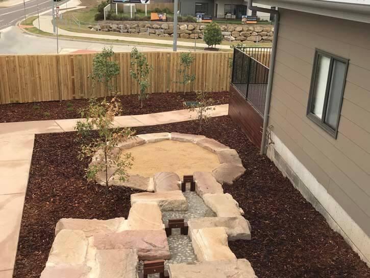 Thornton Playground Sandpit and plants