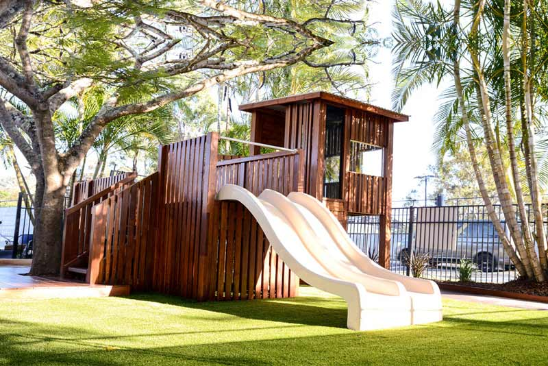 Bright Buttons playground Fort with dual slide double platform and climbing wall