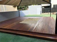 Timber decking around sandpit