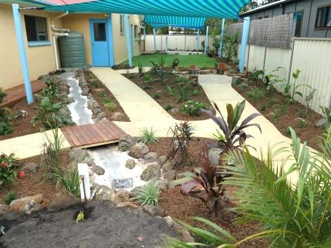 Water Feature, plants, and a dry creek bed