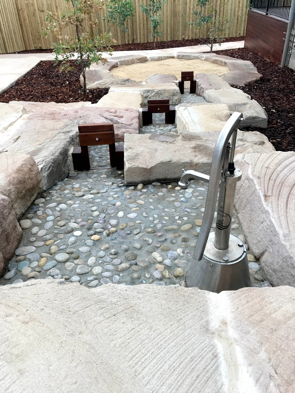 Water feature - brick and pebbled concrete down hill