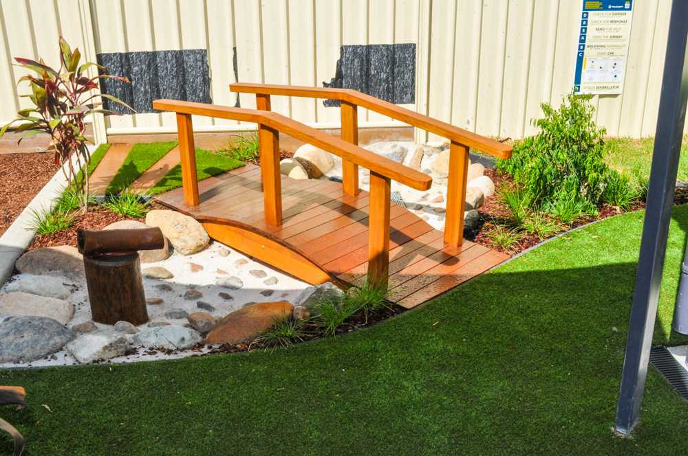 Playground Exterior landscaping, dry creek bed and bridge