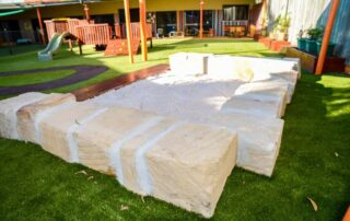 Sandstone and timber sandpit