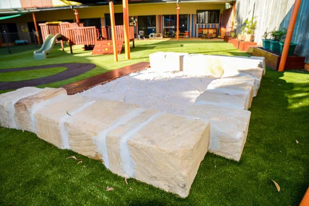 Sandstone and timber sandpit