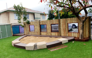 Custom sandpit - sandstone and timber edging