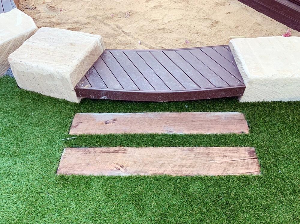 Sandpit edging entrance - timber with sandstone