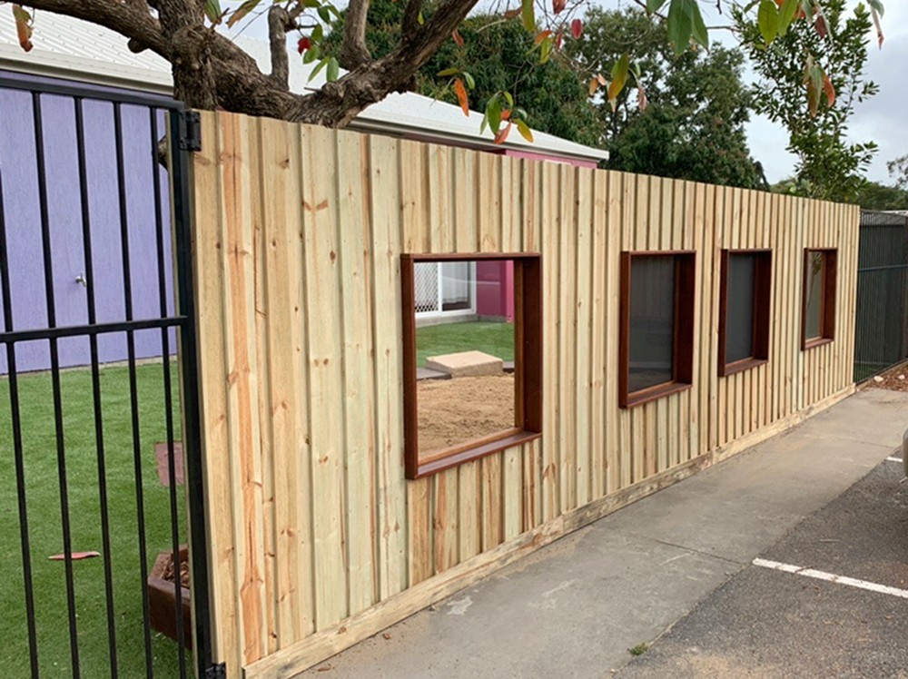 Custom fence with viewing panels