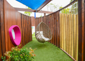 Hanging chair in sensory structure