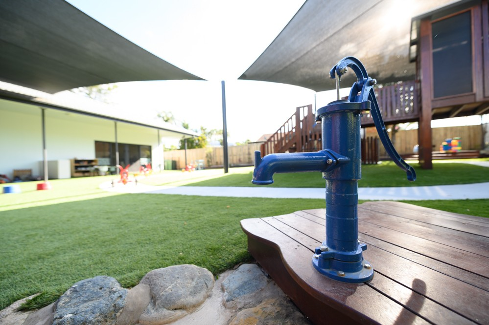 water play - water pump for dry creek bed