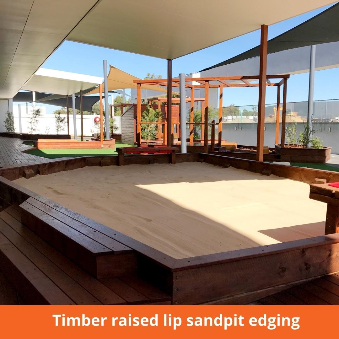 Timber raised lip sandpit edging
